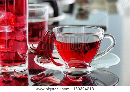 Cup Of Hot Hibiscus Tea (rosella, Karkade) On Kitchen Table