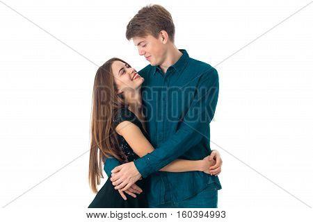 charming elegant couple in love having fun in studio on white background