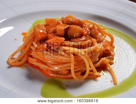 Spaghetti with vegetable preparation dish.