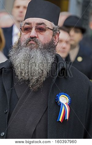 TIMISOARA ROMANIA - DECEMBER 1 2016: Priest who assist at military parade of Romanian National Day. Picture is taken in front of the Administrative Palace in Timisoara.