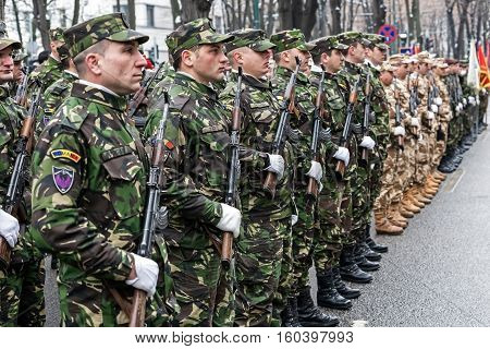 TIMISOARA ROMANIA - DECEMBER 1 2016: Military parade at Romanian National Day. Soldiers in formation. Picture is taken in front of the Administrative Palace in Timisoara.