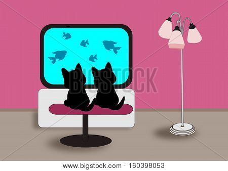 Two black little cats sitting and watching TV.