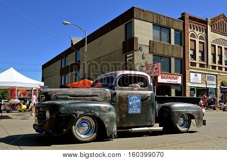 MANDAN, NORTH DAKOTA, July 3, 2016: The 4th of July Rodeo Days 3 day celebration includes the rodeo, Art in the Park, and downtown 4th parade where this old Ford pickup advertises Chrysler in a parade.