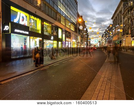 LONDON ENGLAND - DECEMBER 3: JD Sports and blurred people Christmas shopping on Oxford Street London. In London England. On 3rd December 2016.