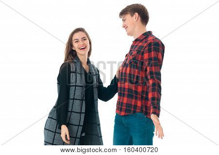 stylish couple in love having fun in studio isolated on white background