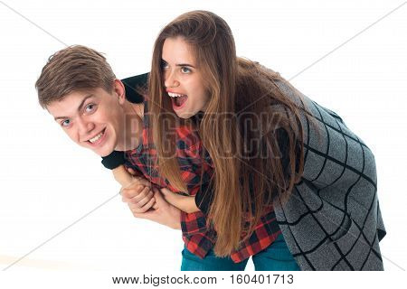 portrait of cheetful stylish couple in love having fun in studio isolated on white background