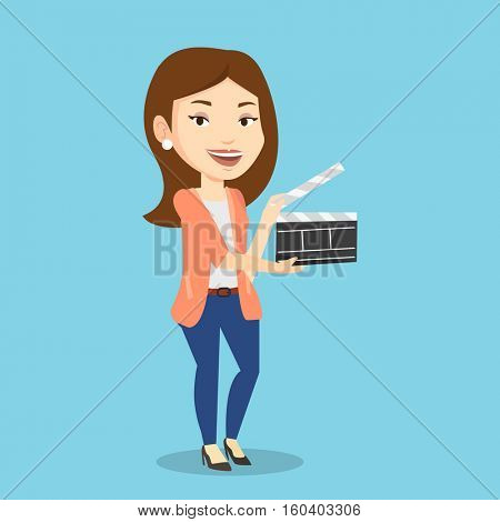 Happy caucasian woman working with a clapperboard. Smiling woman holding an open clapperboard. Cheerful woman holding blank movie clapperboard. Vector flat design illustration. Square layout.