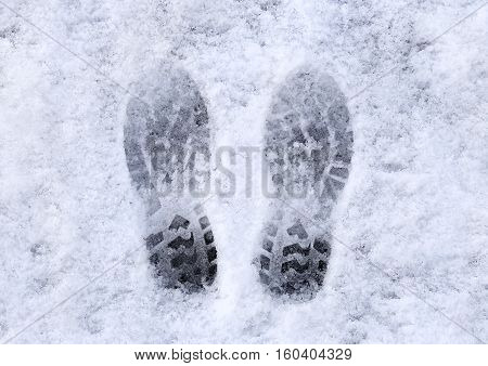 Marks of shoes in the snow background