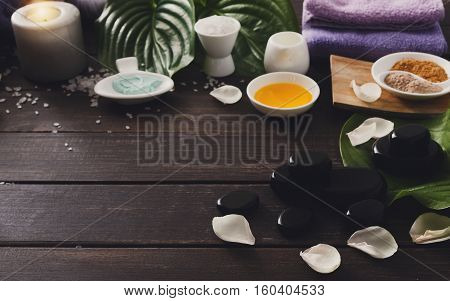 Spa treatment and aromatherapy concept background. Zen stones, aroma salt, spices, herbs, oil and soap, candle and other details of wellness body care and alternative indian medicine.