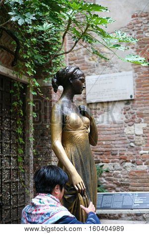Tourist Near Of Juliet Statue In Verona City