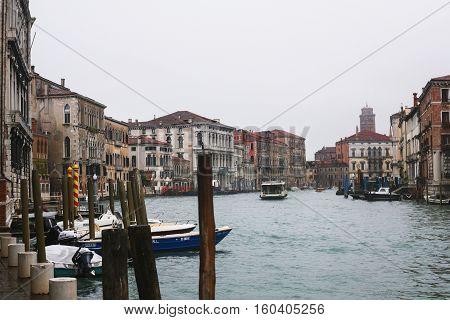 Boats In Canal In Venice City In Rain