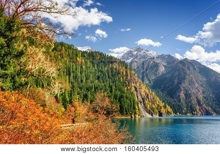 Scenic View Of The Long Lake Among Fall Woods And Mountains