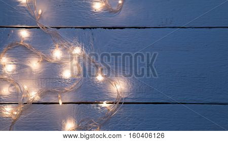 Festoon on empty wooden floor
