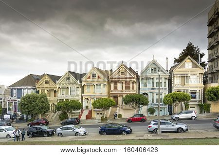 San Francisco, CA, USA, october 26, 2016: Victorian houses known as the Painted Ladies with downtown in the background as viewed from Alamo Square in San Francisco California