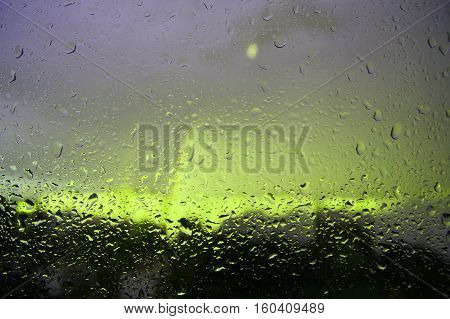 Picture blur of rain drops on glass, lumiere.