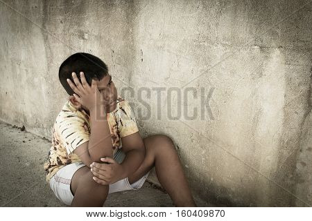 little boy unhappy sad and tress alone vintage tone