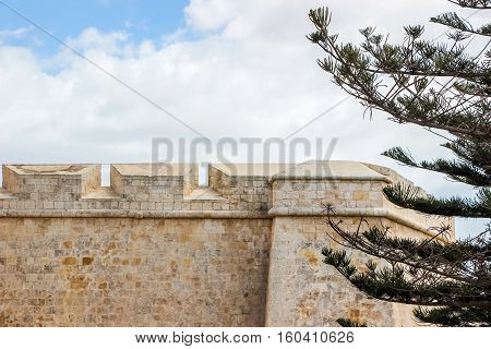 old stone wall at gate in Mdina malta