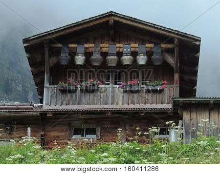 Cowbells hung to hut's balcony in Swiss Alps