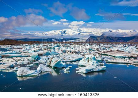 Northern nature. Drift ice Ice Lagoon. The concept of extreme northern tourism. White-blue ice is piled up in the turquoise water of the lagoon
