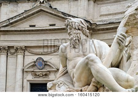 Neptune statue and the building of the church Sant'Agnese in Agone, Piazza Navona, Rome, Italy