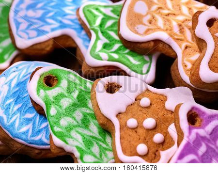 Set of colored cookies close up. Gingerbread Christmas trees and stars.