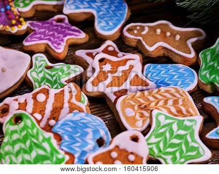 Glazed Christmas cookies on a wooden table. Close-up.