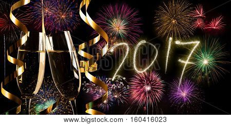 Champagne flutes and fireworks, New Year 2017 concept