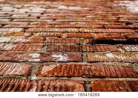 Brickwork. Grunge brick wall. Rough brick wall. Grunge brick background. Wet brick wall. Brick wall