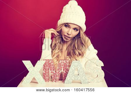 X-mas woman over red background