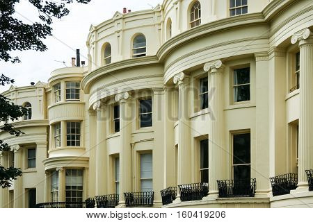 grand facade of regency period houses in brighton east sussex uk