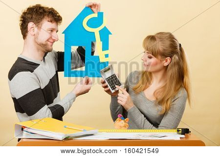 Couple With House And Calculator.
