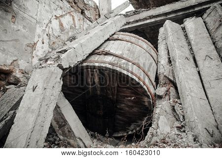Ukraine Odessa area destroyed factory. A huge wooden barrel capacity and the ruins of the destroyed building or premises.