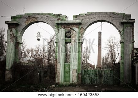Ukraine Odessa area destroyed factory. Ruined stone brick arch and the ruins of the destroyed building or premises.
