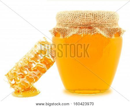 honey in a jar and honeycomb isolated on white background