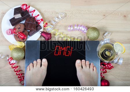 Digital scales with woman feet on them and sign