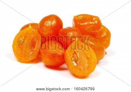 Dried kumquat isolated on a white background.