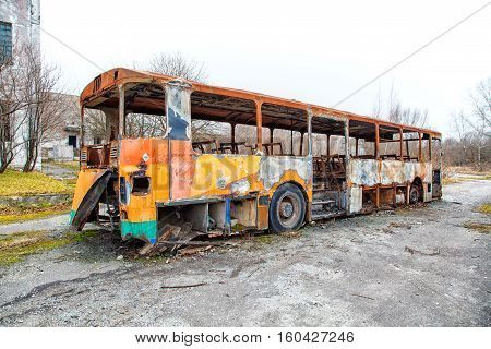 burned the abandoned bus on gloomy cold autumn day