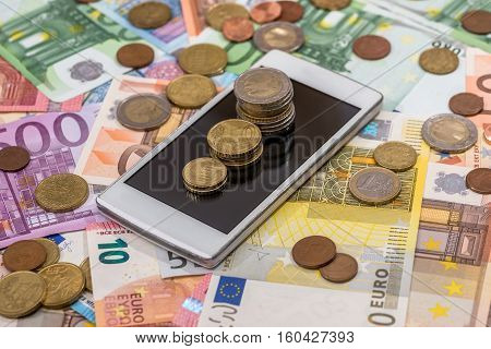 different euro money and phone fro background
