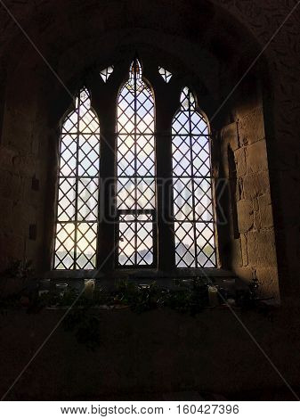 BAKEWELL ENGLAND - DECEMBER 4: Interior view of a window at the chapel at Haddon Hall in Derbyshire England. In Bakewell Derbyshire England. On 4th December 2016.