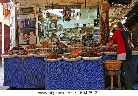 FEZ MOROCCO - MAY 19 2006: Shop selling dried fruit nuts and other foods in the ancient medina Fes el Bali in Fez Morocco.