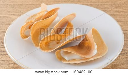 Thai Traditional Snack and Dessert Thai Crispy Pancake or Thai Crepes Filled with Coconut Cream and Fios de Ovos.