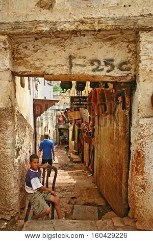FEZ MOROCCO - MAY 19 2006: Entrance to leather shops and the Terrace de Tanneurs which provides a view to the tanneries in the ancient medina Fes el Bali in Fez Morocco.