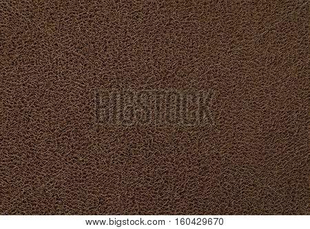 Background Pattern Horizontal Texture of Dark Brown Plastic Doormat.