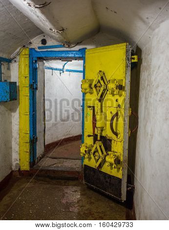 Balaklava, Crimea - September 2016: Door in secret underground submarine base in Sevastopol a secret military installation during the Cold War. Russia.