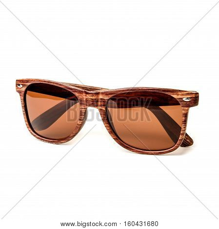 Wooden sunglasses isolated on white background in a studio shot.