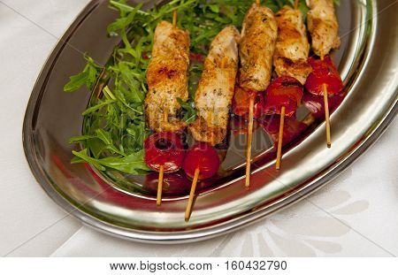 Skewers on the silver plate on the table