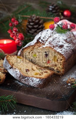 Stollen, traditional Christmas cake with dried fruits and nuts. Christmas food.