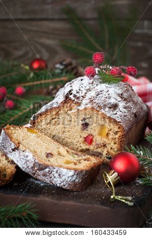 Stollen traditional Christmas cake with dried fruits and nuts. Christmas food.