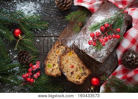 Stollen traditional Christmas cake with dried fruits and nuts. Christmas food. Top view.