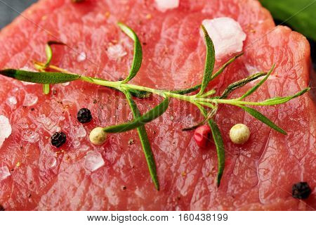 Fresh Raw Beef Steak Mignon With Sea Salt And Rosemary, Balck Pepper .closeup